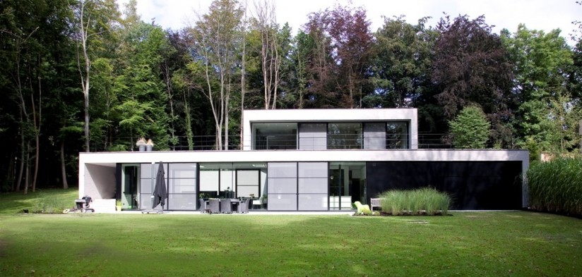 Panoramic windows help make this forest home a haven of peace and privacy
